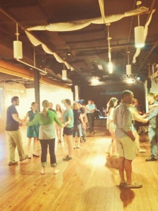 People from the community having fun contra dancing at the Showroom, in downtown Spartanburg, while enjoying the live band, Hey for Four. Photo taken by Esther-Irene Egan.