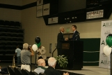 Chancellor Kelly invites Freire to the stage to share his vision.